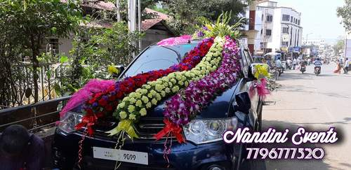 Pink theme wedding car decoration with pink lilies and ribbon