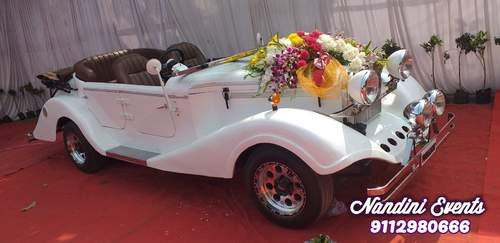 Wedding car decoration with single bouquet & ribbon on bonnet