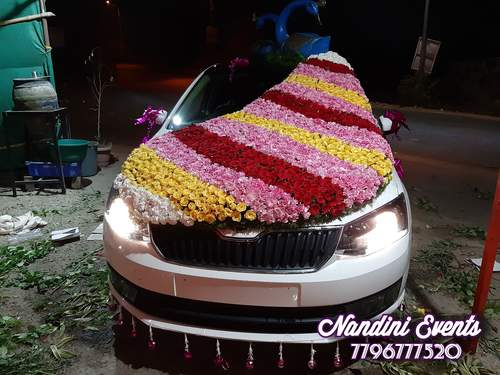 Wedding car decoration with everything cute teddies, flowers & ribbons